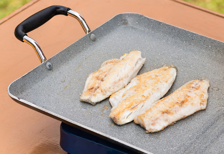 sea bream: Pictured three fillets of sea bream cooked on the grill outdoor. Stock Photo