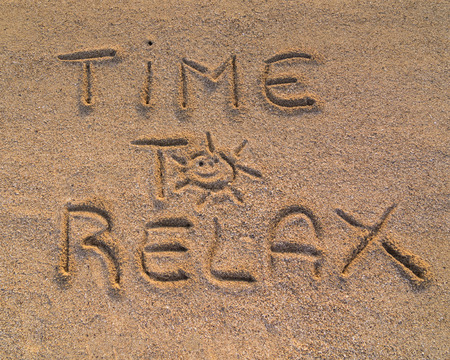 strong message: In the picture the words on the sand Time to relax