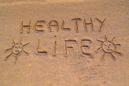 healty: In the picture the words on the sand Healty life. Stock Photo