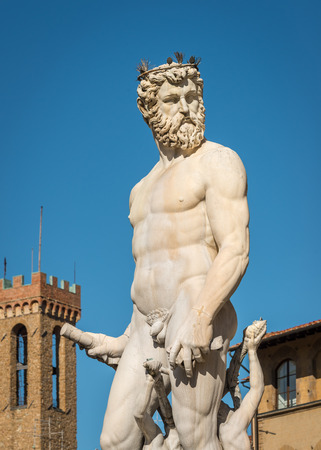 naked statue: Close-up at Statue of Neptune with tower in background, Piazza della Signoria, Florence Italy
