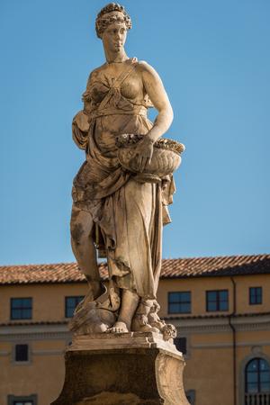 river arno: Statue on the bridge of Santa Trinita over the river Arno in Florence, Tuscany, Italy