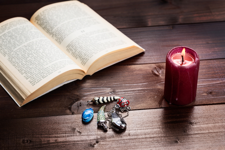 cartomancy: Composition of esoteric objects,candle and book used for healing and fortune-telling. Stock Photo