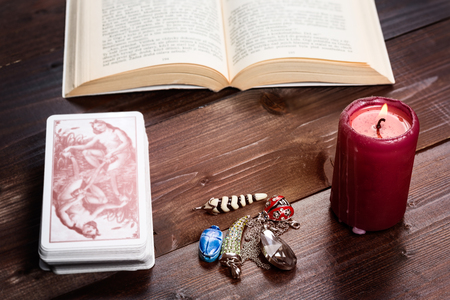 fortunetelling: Composition of esoteric objects,candle,cards and book used for healing and fortune-telling.