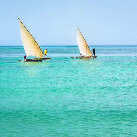 In the picture two traditional catamaransNgalawa on amazing turquoise water in the Indian ocean.