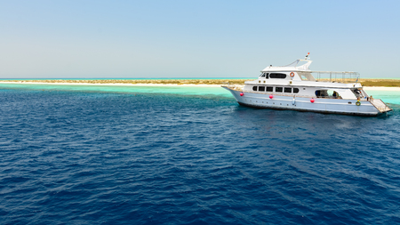 alam: In the picture a yacht anchored near the port of Hamata , Egypt Red Sea