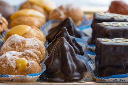 pictured: In the pictured colorful pastries with candied,cream and chocolate, the real Italian confectionery. Stock Photo