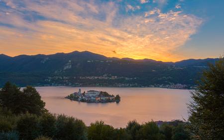 orta: A View of San Giulio Island at sunset, Lake Orta, Italy