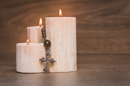 Black rosary on the Candle at wooden table,religion concept,vintage style. 写真素材