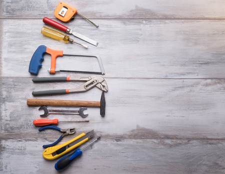 Screwdriver,hammer,tape measure and other tool for construction tools on gray wooden background with copy space,industry engineer tool concept.still-life. 写真素材