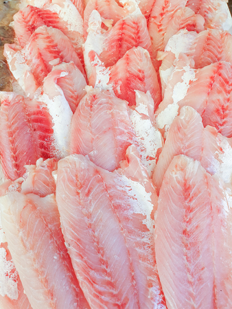 African perch fillet on ice for sale, Fish local market stall with fresh water fish,view from top.