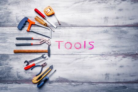 Set of work tool on rustic wooden background with written tools in space, industry engineer tool concept.still-life. 写真素材