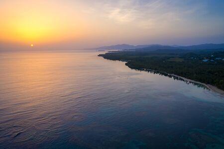 Aerial view of tropical beach at sunrise.Samana peninsula,Bahia Principe beach,Dominican Republic. Фото со стока