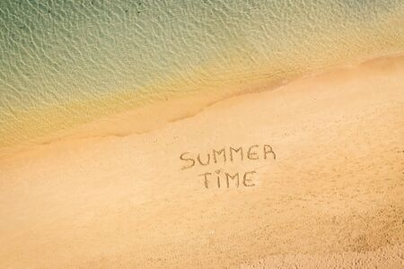 aerial view of the inscription on the sand Summer Time, Caribbean beach and ocean seen from above