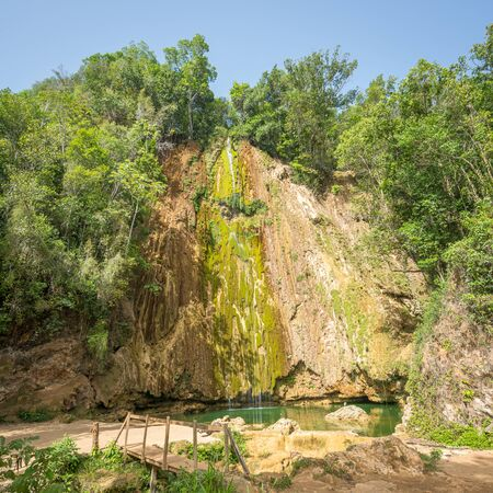 Panorama of the wonderful El Limon tropical waterfall with a lot of moss and steaming water, looks under the waterfall in the Dominican republic of the samana peninsula.