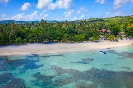 Aerial photography of tropical beach and boat while sailing .Samana peninsula,Rincon beach,Dominican Republic. Фото со стока - 133067167