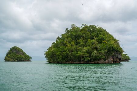 Los Haitises National Park nicknamed the Caribbeans Halong Bay.Mangroves, caves, a rich tropical forest, multicolored tropical birds and manatees. The coast is dotted with small islets where frigates and pelicans nest.Samana peninsula, Dominican Republic.