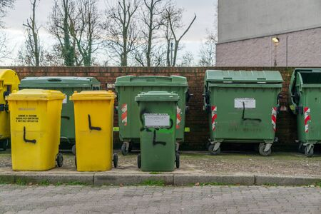Milan, Italy - December 02, 2019: selective waste collection bins empty
