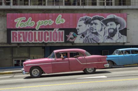 castro: American cars under a cuban propaganda billboard, Havana, Cuba Editorial