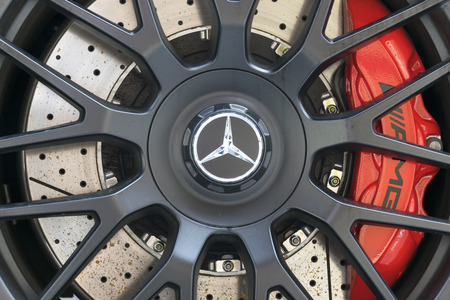 alloy: TURIN, ITALY - JUNE 13, 2015: Close-up of the wheel of a AMG GT model, with the Mercedes logo on the center Editorial
