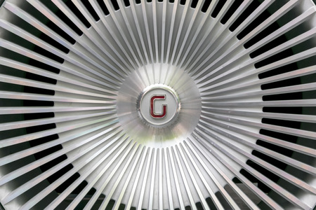 alloy wheel: TURIN, ITALY - JUNE 13, 2015: Detail of the alloy wheel of a Giugiaro concept car, with the logo on the center
