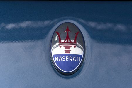 12 13: TURIN, ITALY - JUNE 13, 2015: Close-up of the classic Maserati logo on the body of a MC 12 model