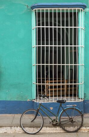 colonial house: Green bicycle in front of a colonial house in Trinidad, Cuba