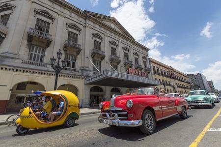 Classic car and Cocotaxi in Havana, Cuba