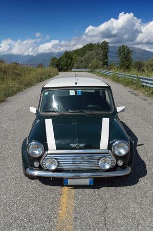 Green classic Mini Cooper on the road