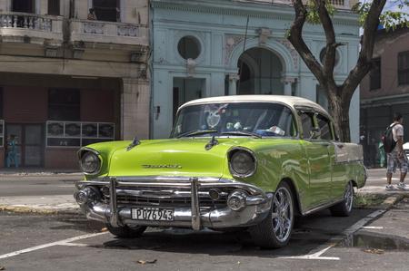 Vintage green car parked in Havana, Cuba.