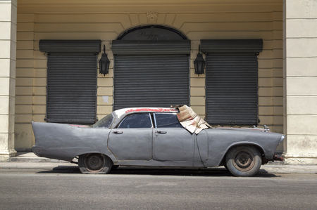 abandoned car: Abandoned vintage car on the streets of Old Havana in Cuba