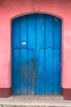 colonial building: Blue door of a pink colonial building in Trinidad, Cuba