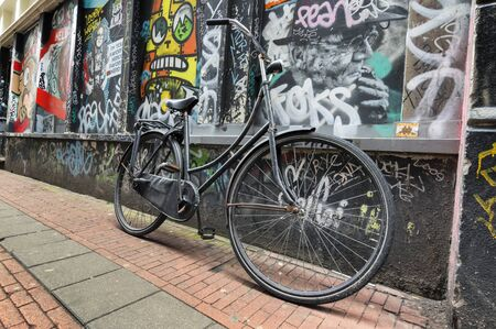dutch typical: Dutch typical bicycle with graffiti on the background in Amsterdam
