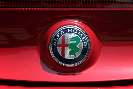 romeo: TURIN, ITALY - JUNE 9, 2016: Alfa Romeo logo on a red car body