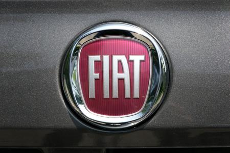 fiat: TURIN, ITALY - JUNE 9, 2016: New Fiat logo on a dark gray body