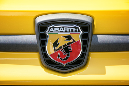 fiat: TURIN, ITALY - JUNE 9, 2016: Fiat Abarth logo on a yellow car body Editorial