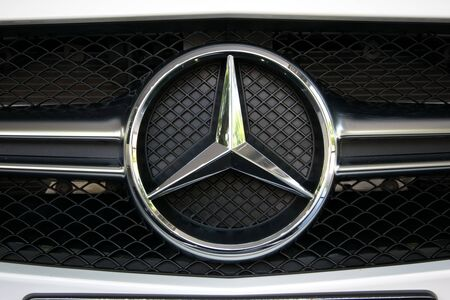 benz: TURIN, ITALY - JUNE 9, 2016: Closeup of a Mercedes Benz AMG logo on a car model
