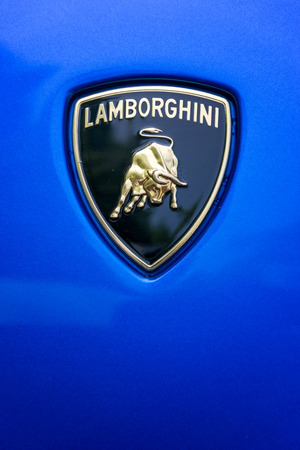 lamborghini: TURIN, ITALY - JUNE 9, 2016: Lamborghini logo on the hood of a blue car body Editorial
