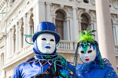 venice carnival: White masked couple at Venice carnival
