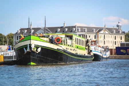 Amsterdam, The Netherlands - July 15, 2011   Boats sailing on the Ij lake in Amsterdam, The Netherlands