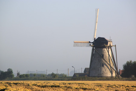 Old wind mill in the countryside  Stock Photo