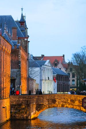 Bruges, Belgium - December 28, 2013 People are crossing a bridge of the Blinde-Ezelstraat in Bruges