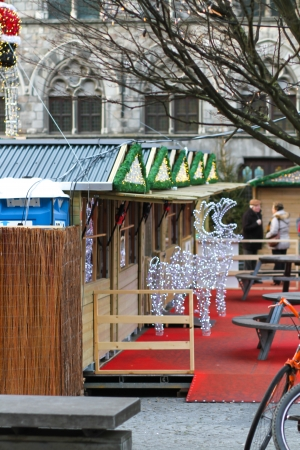 Ypres, Belgium - January 2, 2014 People are wandering at the Christmas market in Ypres, Belgium  Editorial