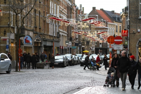 Ypres, Belgium - January 2, 2014 People are rambling in Boter Street in Ypres during Christmas time  Editorial