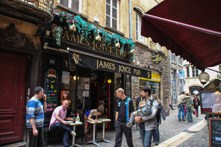 Lyon, France - May 19, 2012 People are walking by an Irish pub in the very popular Saint Jean Street in Lyon