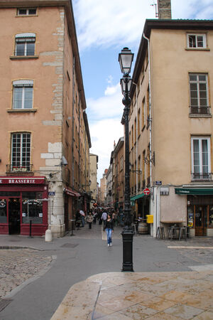 Lyon, France - May 19, 2012 People are enjoying shopping in the very popular Saint Jean Street in Lyon