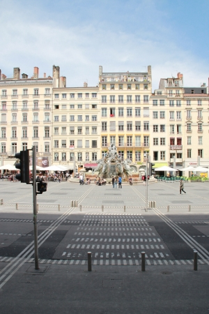 Lyon, France - May 20, 2012 People are crossing the Place of Terreaux in Lyon, France  Editorial
