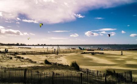 Beach with kite surfers  Stock Photo