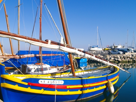 Old fishing boats in a french port along the Mediterranean sea