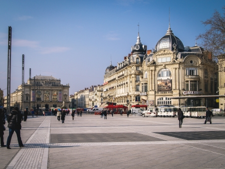 wheather: Montpellier, France - November 3, 2010 People are enjoying walking the main plaza  Place de la Comédie  in the heart of Montpellier in the south of France  The wheather is nice despite the fact that it Editorial