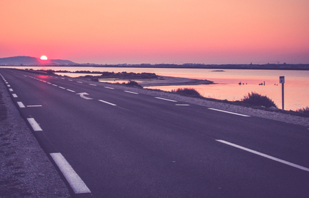Sunset on a road Stock Photo